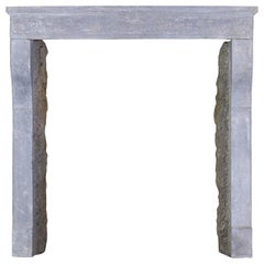 17th Century Small French Rustic Limestone Antique Fireplace Surround