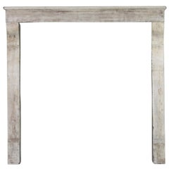 17th Century Small French Country Limestone Antique Fireplace Surround