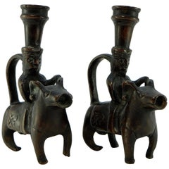 Iran 18th-19th Century, Pair of Bronze Candlesticks Characters on Rams