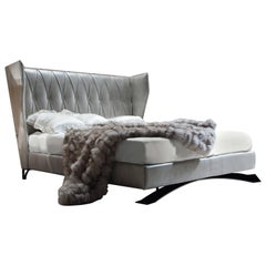 Giorgio 'Alchemy' Upholstered Bed Lizard Printed Leather Wingback Headboard