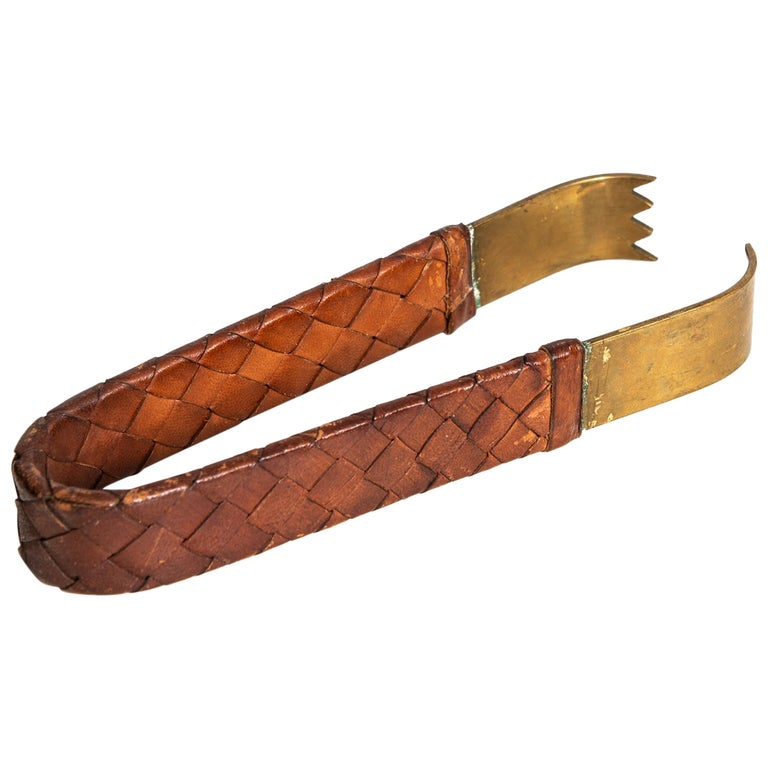 Carl Auböck Pincer in Braided Leather and Brass For Sale