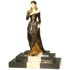 French Art Deco Figure of a Lady Descending a Marble Staircase by E. Mennevile