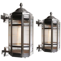 Pair of Large Stainless Steel and Ribbon Glass Sconces