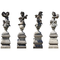 Four Lovely Italian Putto Stone Garden Statues Representing Musicians