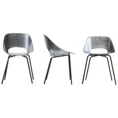 "Pierre Guariche, Set of Three ""Tonneau"" Cast Aluminum Chairs, circa 1950-1959"