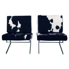 Pair of Stainless Steel and Cowhide Lounge Chairs