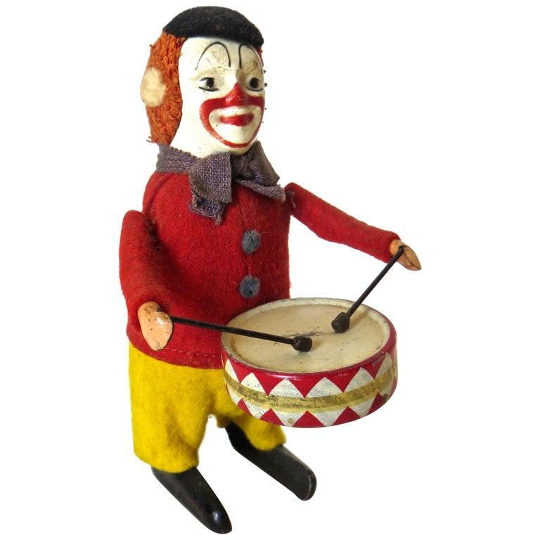 """""""Clown Drummer"""" Clockwork Toy Schuco, German, circa 1940 For Sale"""
