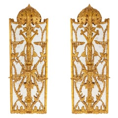 Pair of Hollywood Regency Gilt Carved Mirrors