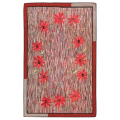 Antique American Floral Hooked Rug. Size: 5 ft 6 in x 8 ft 4 in