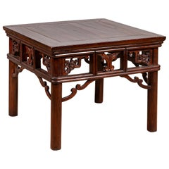 Chinese Antique Side Table with Open Fretwork Design and Dark Wood Patina