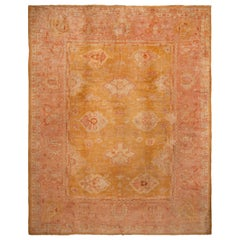Antique Oushak Orange and Light-Red Wool Rug with Geometric Patterns