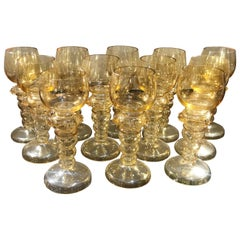 Set of 12 19th Century Hand Blown Iridescent Amber Glass Rhine Wine Glasses