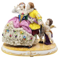 Porcelain Couple with Cherub Playing Hide and Seek