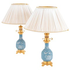 Pair of Blue Porcelain Lamps with a White Enameled Decor, circa 1880