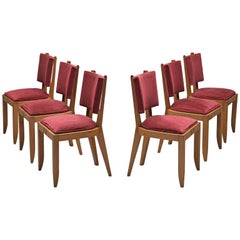 Charles Dudouyt Set of Burgundy Fabric and Oak Dining Chairs