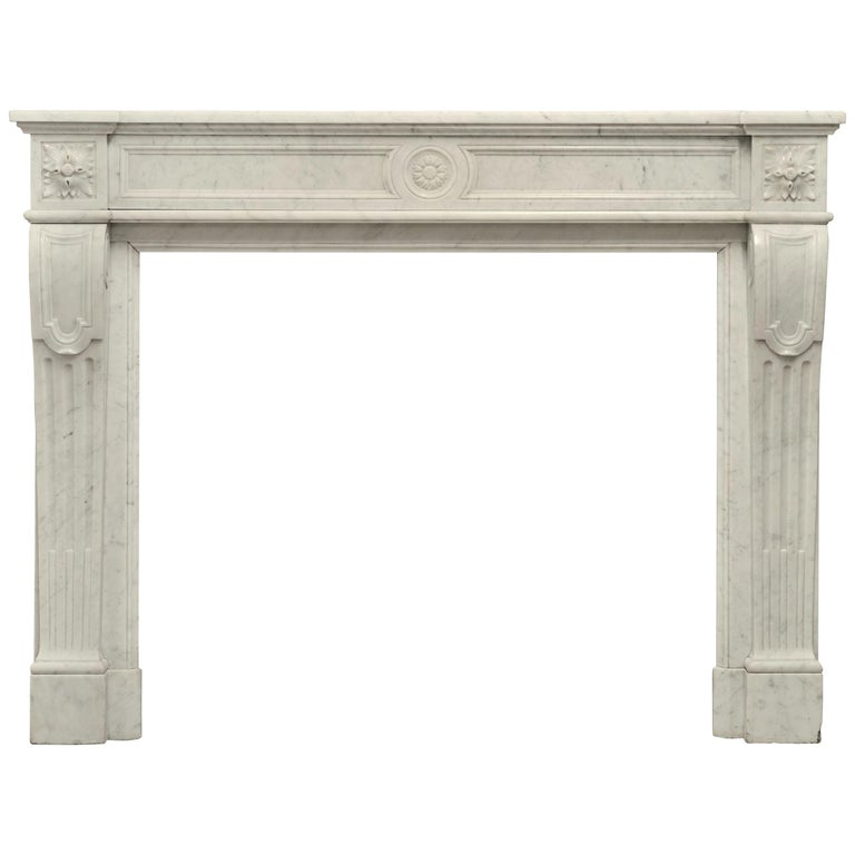 Stylish French Louis XVI Fireplace in Carrara White Marble For Sale