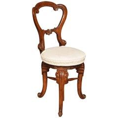 Walnut Revolving Music Chair