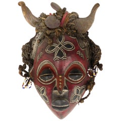 Cameroon Bamileke Tribal Carved Horned Mask Embellished with Sea Beans & Beads