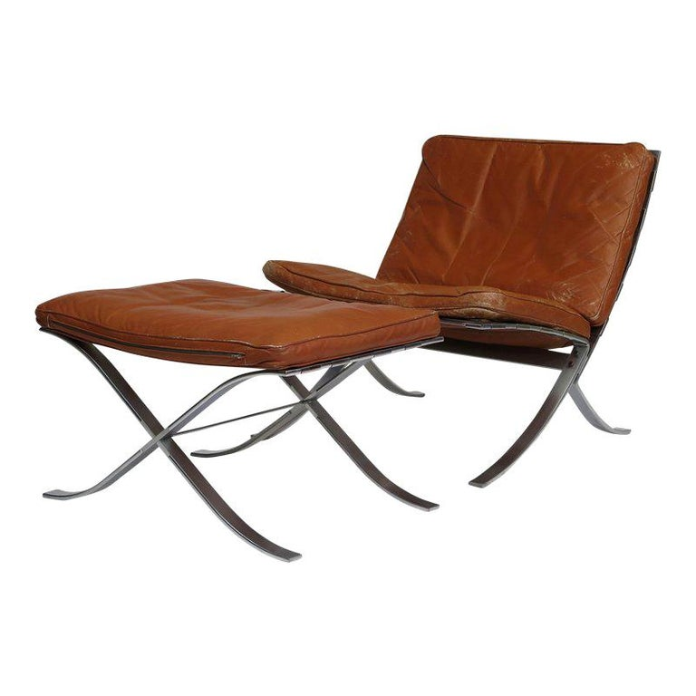 Steen Ostergaard Steel and Leather Lounge Chair and Foot Stool For Sale