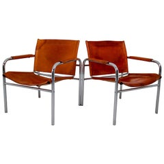Two Midcentury Tubular Armchairs in Patinated Cognac Leather, France, 1960s