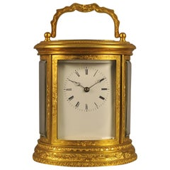 Oval Engraved Bell Striking Carriage Clock with Case