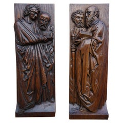 Pair of Hand Carved Antique Wall Plaques with Apostles or Clergyman Sculptures