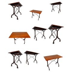 Nine Cast Iron Bistro Tables or Cafe Tables with Patinated Oak Top, France, 1900