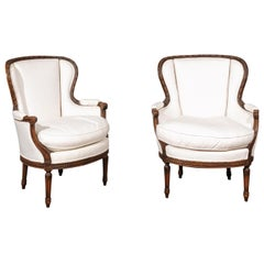 Pair of French Louis XVI Style 19th Century Upholstered Wingback Bergère Chairs
