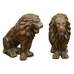 Pair of Italian 1880s Small Walnut Hand Carved Lion Sculptures with Dark Patina