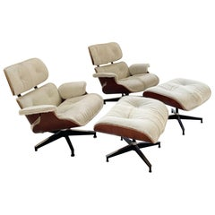 Charles and Ray Eames for Herman Miller Chairs and Ottomans Restored in Cowhide