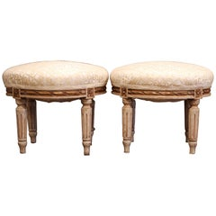 Pair of Early 20th Century French Louis XVI Carved Painted and Gilt Footstools