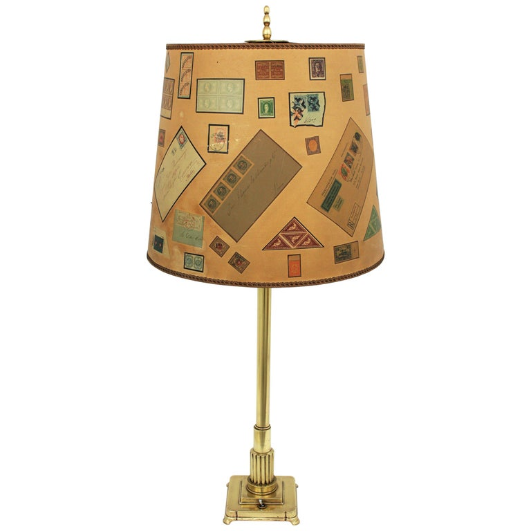 French Art Deco Polished Brass Column Table Lamp with Letters and Stamps Shade For Sale