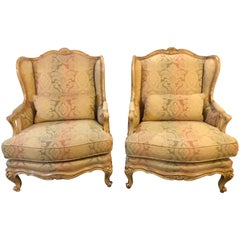 Pair of Distressed Palatial Louis XV Style Wingback or Bergere Chairs