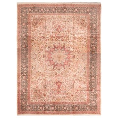 Antique Tabriz Medallion-Style Pink Wool Rug with Floral Patterns