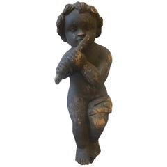 Wooden Sculpture of a Cherub Playing the Flute Sicily, circa 1900
