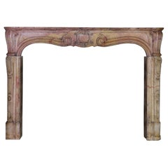 18th Century French Antique Fireplace Surround in Stone Out of a Panel Room