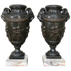 Pair of 19th Century Spelter Mantel Urns on Marble Bases