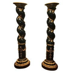 Pair of Monumental Italian Ebonized and Parcel-Gilt Columns
