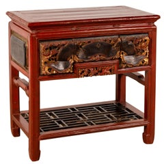 Chinese Red Lacquered Console Table with Hand Carved Drawers and Geometric Shelf