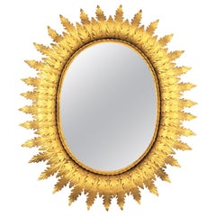 Spanish 1950s Hollywood Regency Oval Gilt Metal Leafed Sunburst Mirror