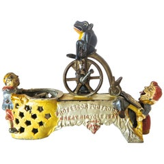 """Professor Pug Frog Great Bicycle Feat"" Mechanical Bank, American, circa 1886"