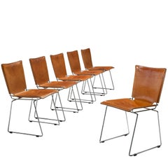 Set of Six Tubular Dining Chairs with Patinated Cognac Leather