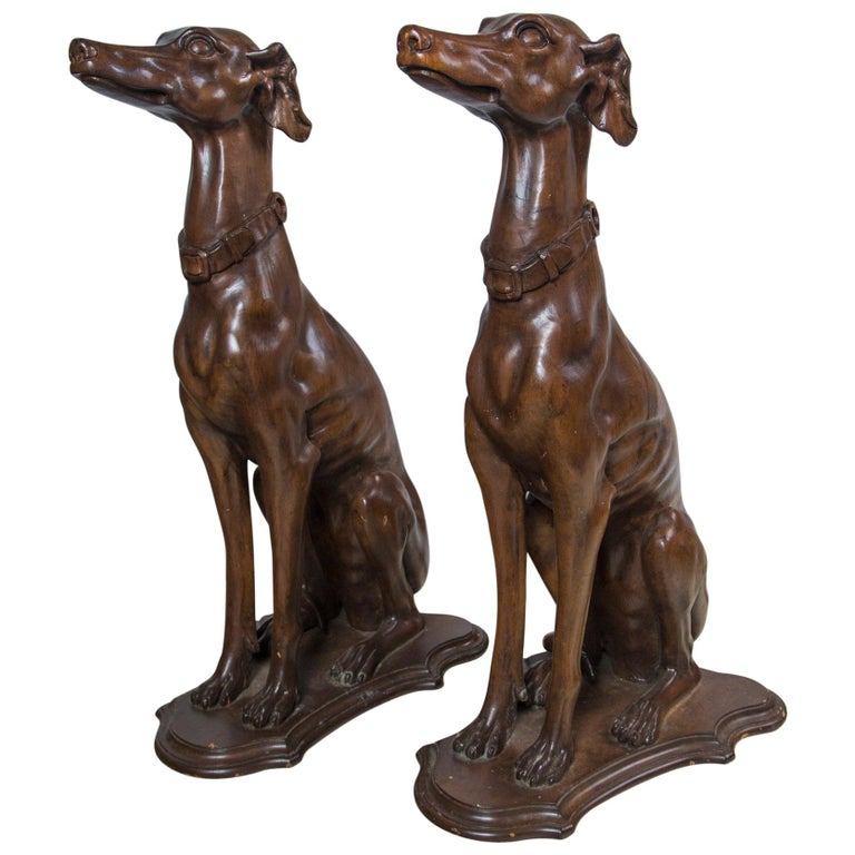 Pair of Carved Wood Dogs For Sale