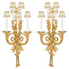 A pair of French 19th Century Louis XVI st. ormolu five arm sconces