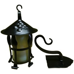 A Pair of Arts & Crafts Black Enamelled Vaseline/Uranium Hanging Wall Lanterns