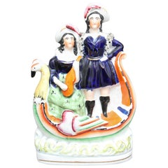 Staffordshire Figure of a Man and Woman in Boat