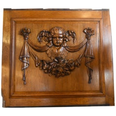 Walnut Panel with Carved Cherub