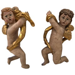 Pair of Antique Carved Wood and Gilded Cherub Sculptures