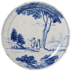 English Delftware Plate with Scene of Two Figures in a Rural Landscape, 1740
