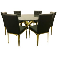 Round Glass and Brass Dining Table and 6 Black Leather Chairs